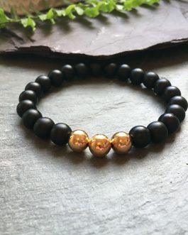 Black and Gold Stylish Bead Bracelet. 3 Rose coloured metal beads